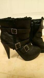 Black faux leather/fur platform heel boots with silver buckles