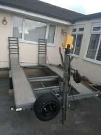 Car transporter trailer Carcaddy with folding towing bar.