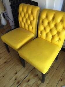 2 designer yellow leather chairs