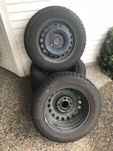 4 WINTER TIRES w/STEEL RIMS - $300