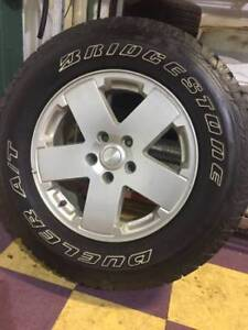 Set of 5 Rims and Tires for Jeep Wrangler (Stock) - $1000