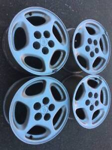 "Set of Oem genune 16"" nissan 300zx rims all in good used cond"