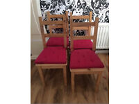 Four dining chairs with seat covers