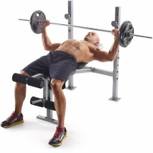 bench press with wide range of metal weights