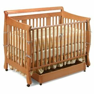 Stork Craft 4-in-1 convertible crib and matching change table