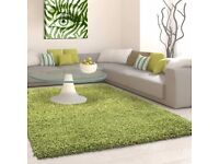 Hardly used green Fluffy rug in very good condition only £30