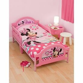 Minnie Mouse Child's Bed with mattress and Minnie mouse bedding included. Excellent condition.