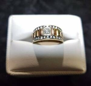 14k Gold Ring Surrounded by Diamonds $450