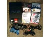 Playstation 2 with two controllers, games and extras