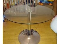 Round top, glass dining table