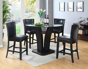4 foot round glass bistro table with 4 hardwood counter chairs