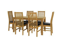 Ex display Penley Oak Stain Extendable Table and 6 Paris Black Chairs