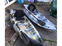 2 sit on top sea kayaks with seats and paddles