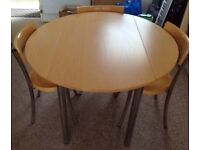 Circular folding dining table and 4 chairs in beech and chrome