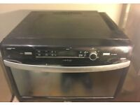 Whirlpool JT369 31L Combination Microwave Oven