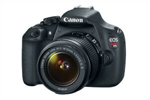 Canon Rebel EOS T5 camera and 18-55mm zoom lense. $300.