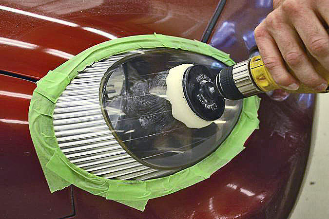 Sanding and polishing is easier with power drill attachments, but tape off the area surrounding the headlight