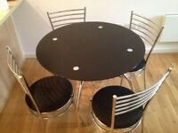 Round black glass dining table only chairs not included