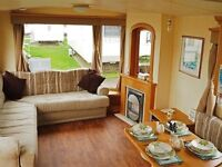 OWNED STATIC CARAVAN FOR SALE SITED ON FAMILY PARK IN NORTH WALES WITH SITE FEES PAID