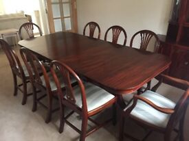 Beautiful dark Wood dinning table and 8 chairs