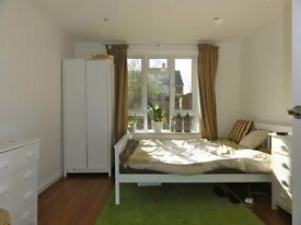 LARGE BEDROOM in a modern house available immediately
