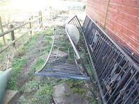 iron ornate fencing / railing used for edging of a patio to secure babies and dogs a bridge too