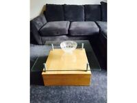 Square coffee table with storage space and glass top