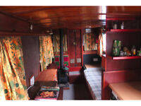 A Small Studio Apartment Space on a Barge / Boat House
