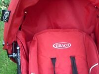 RED GRACO PUSH CHAIR IN VERY GOOD WORKING CONDITION