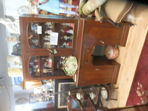 Antique Victorian walnut desk with bookcase top.