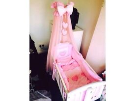 White rocking crib for sale with bet set and drape