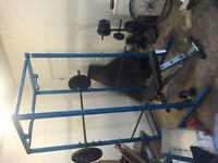 Steel weights, adjustable flat-bench, and squat rack