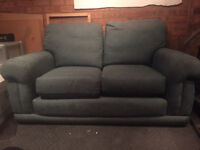 2 green 2-seater sofas (need covers, well worn). Free to collector.