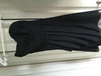 Two black matching bridesmaid dresses or prom dresses