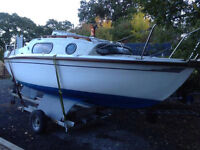 Leisure 17 Bilge Keeled sailing boat, with new sails, trailer, outboard.