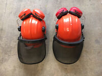 Pair of chainsaw protection helmets