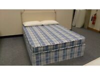 Brand-new, double bed, complete mattress & divan base. Bargain.
