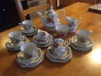 20 piece country style and large tea set and large tea pot