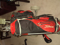 Golf clubs, bag and cart