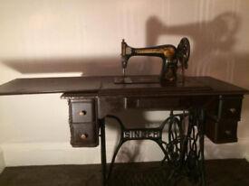 Vintage Singer sewing machine table, in working order.