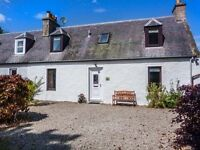 Welcoming Holiday Rental stone cottage in the sunny coastal town of Nairn in the Scottish Highlands.