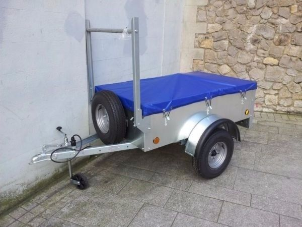 Small trailer with waterproof cover spare