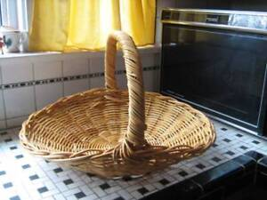"""Lge. 20""""x20"""" Wicker Basket with Handle--$20."""