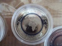 """German €5 euro """"Planet Earth"""" coin with blue plastic inner ring."""