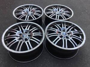 "Set of aftermarket BMW M3 style 67 18"" rims in fair used cond"