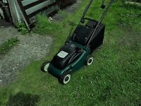 Small, cordless lawn mower.