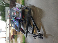 2 Polaris sleds and trailer, need gone.