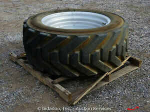 IN44550D710 OTR OUTRIGGER FOAM FILLED 18 PLY TIRE ON RIMS