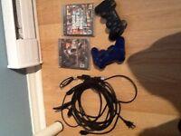 PS3 élite 250gb vien avec deux jeu et deux manette