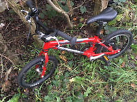 """Isla Cnoc 14"""" red bike, light and easy to ride."""